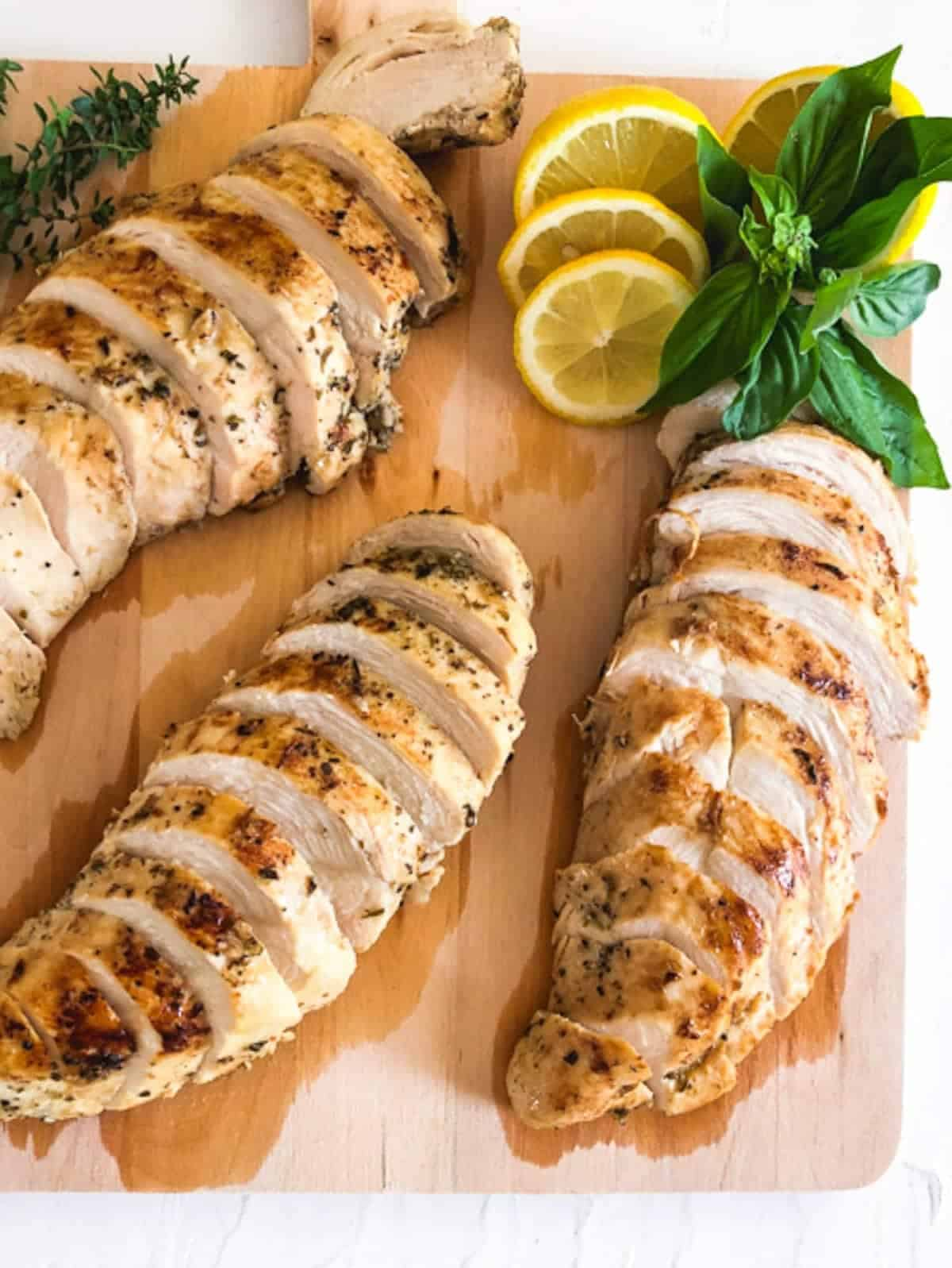 sliced chicken breast on a wooden chopping board