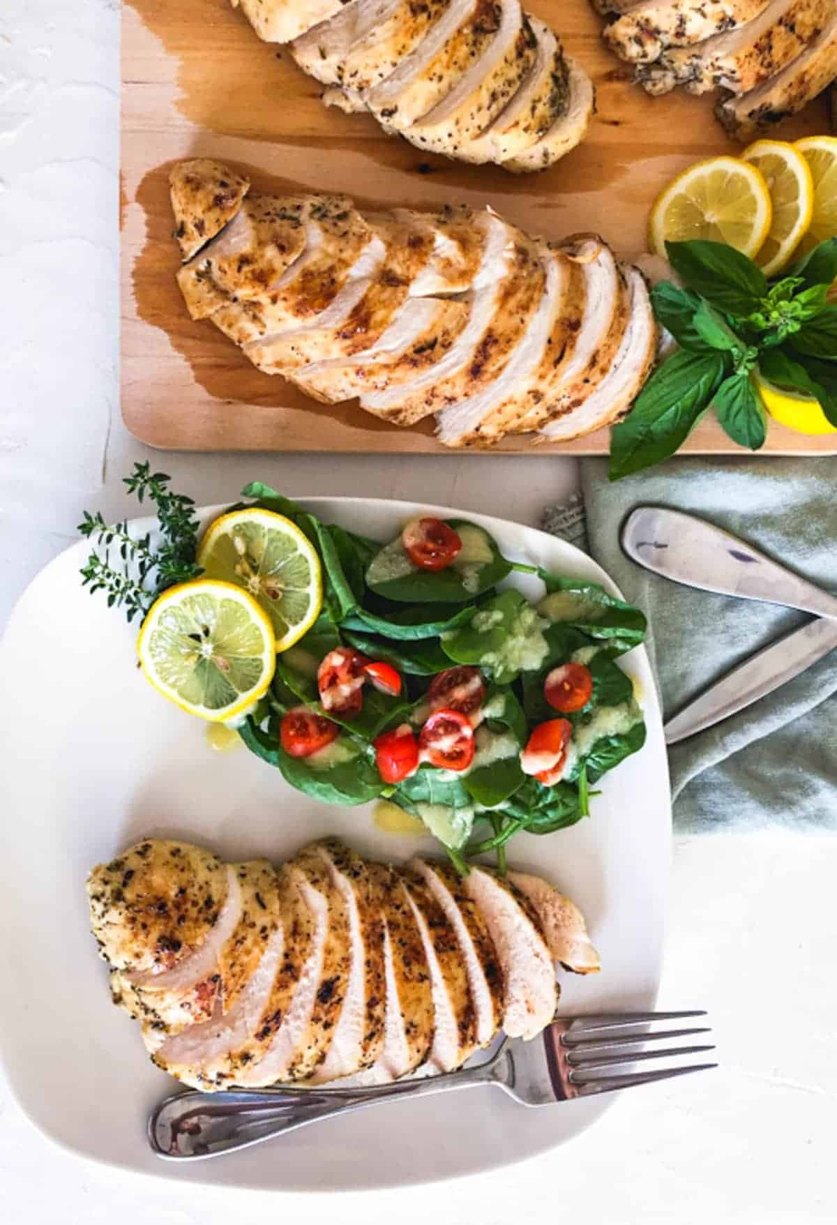 Sous vide chicken breast served with a side salad