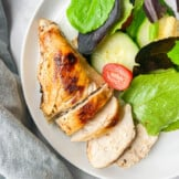 sous vide chicken breast with salad on plate
