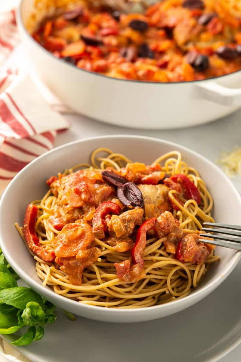 bowl of chicken cacciatore over pasta