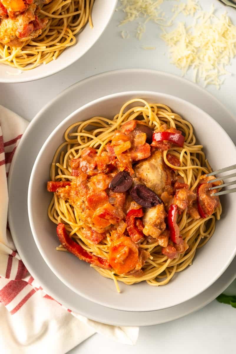 overhead image of chicken cacciatore served with pasta