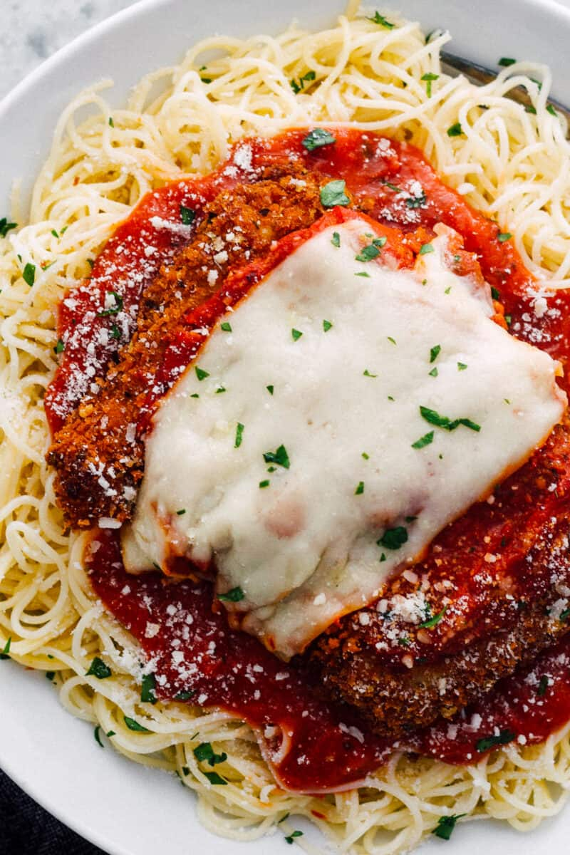 easy chicken parmesan over sauce and pasta