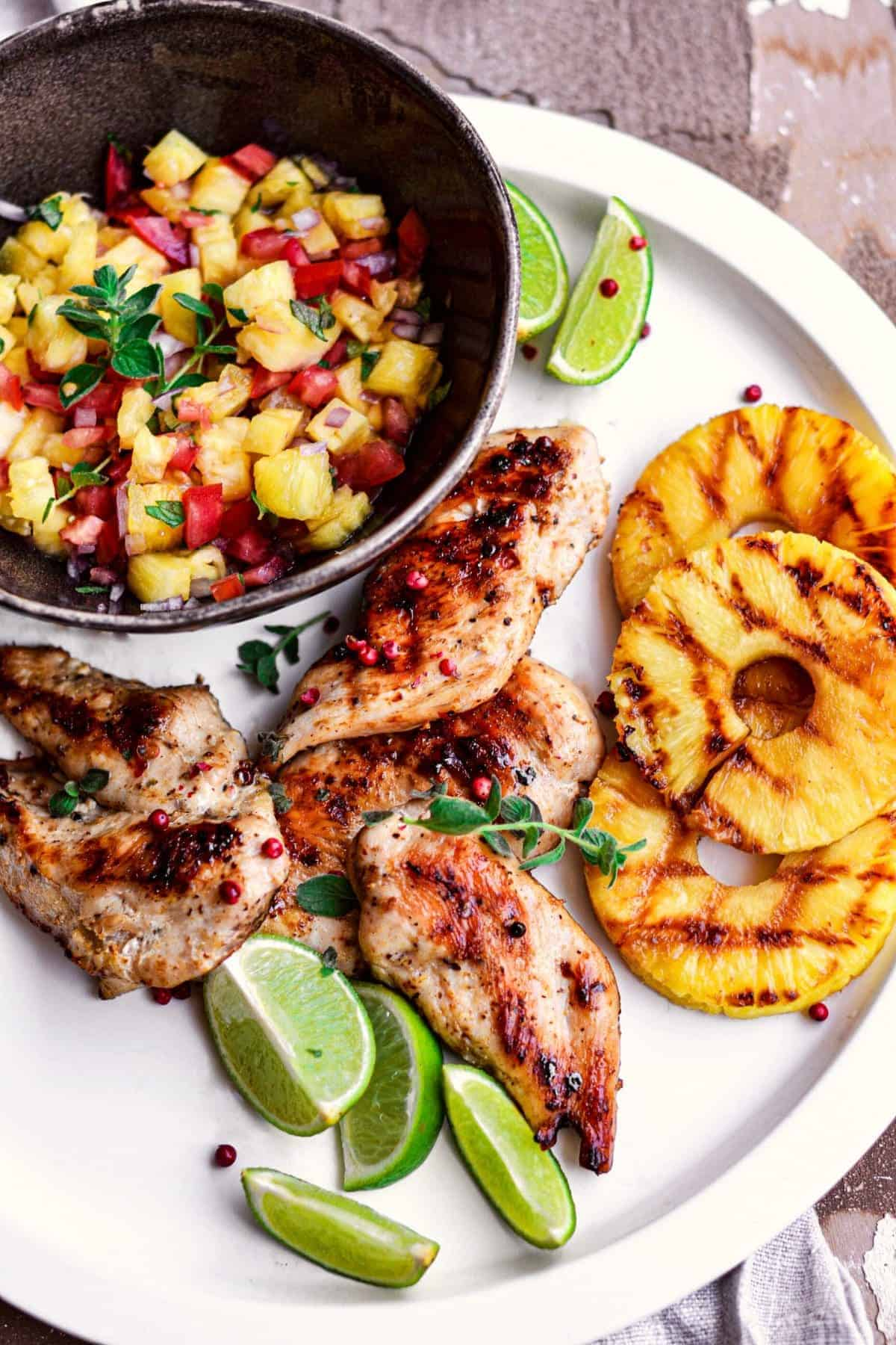 Grilled Chicken with Pineapple Salsa served with lime wedges