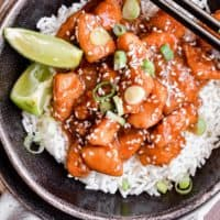 orange chicken in a bowl over rice