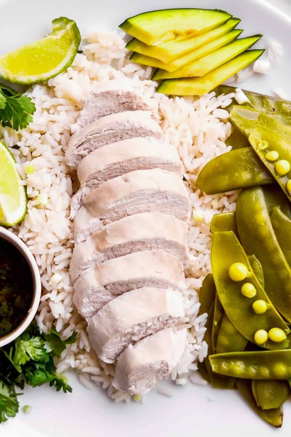 poached chicken breast served on rice