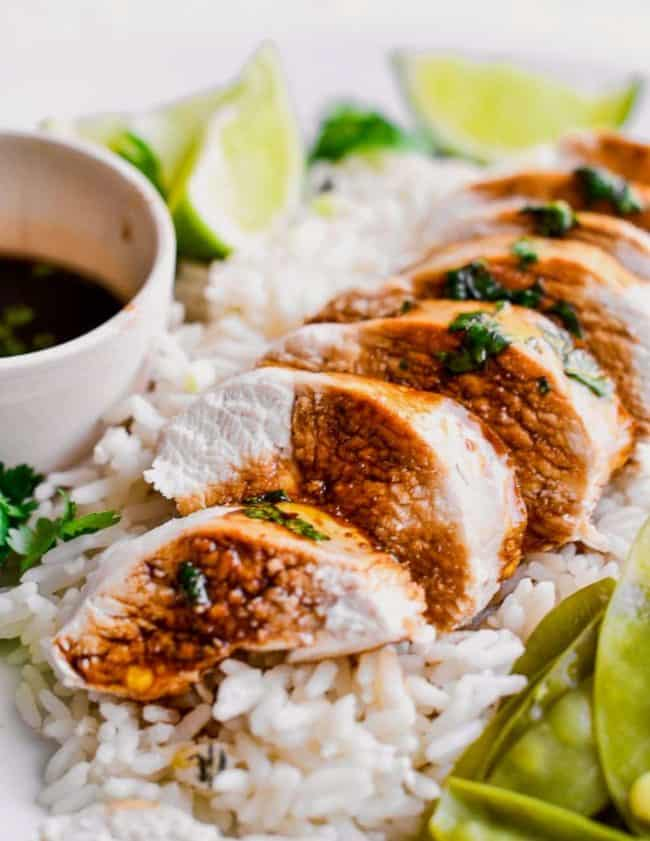 poached chicken with sauce and rice