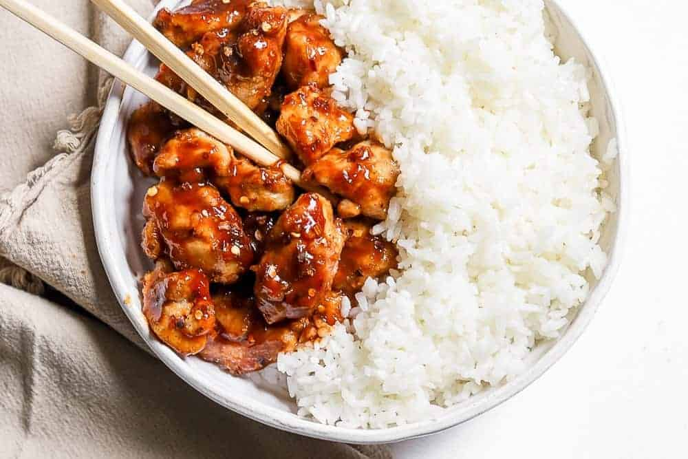 chopsticks on a plate of air fryer general tso's chicken