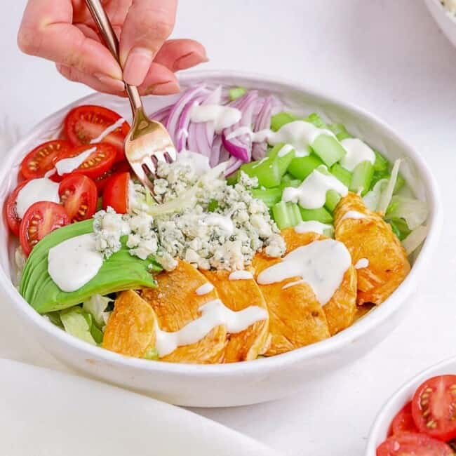 buffalo chicken salad in bowl with fork
