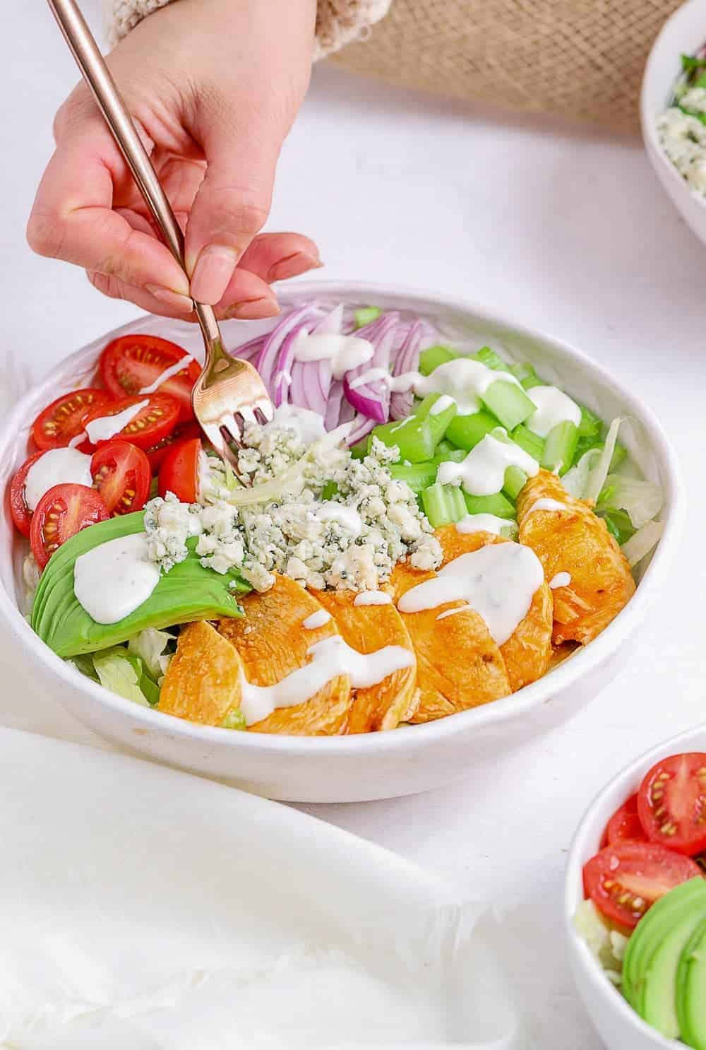 fork in buffalo chicken salad