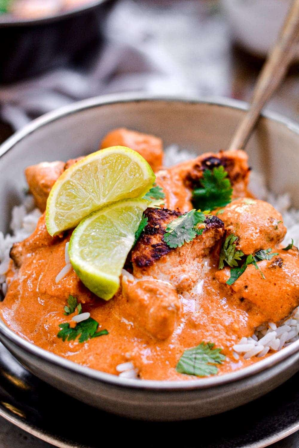 A fork in the butter chicken served in rice
