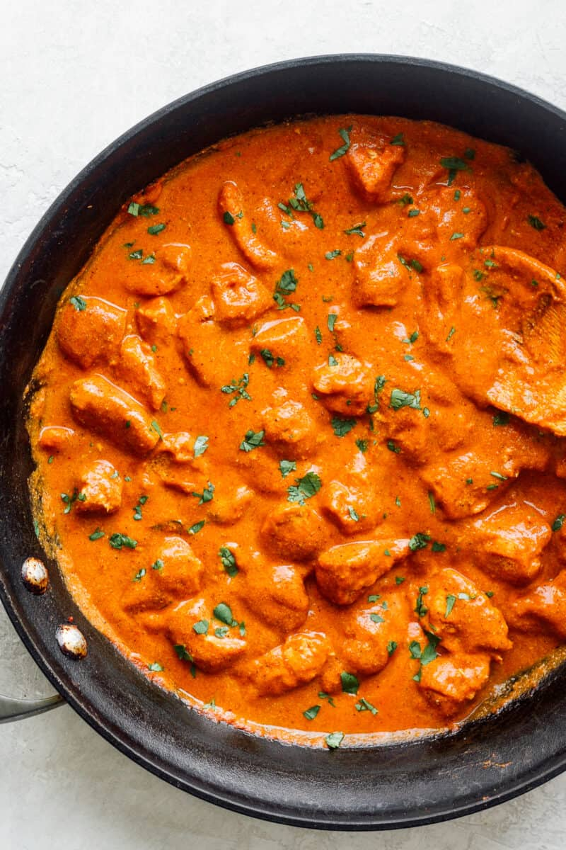 butter chicken in cast iron skillet
