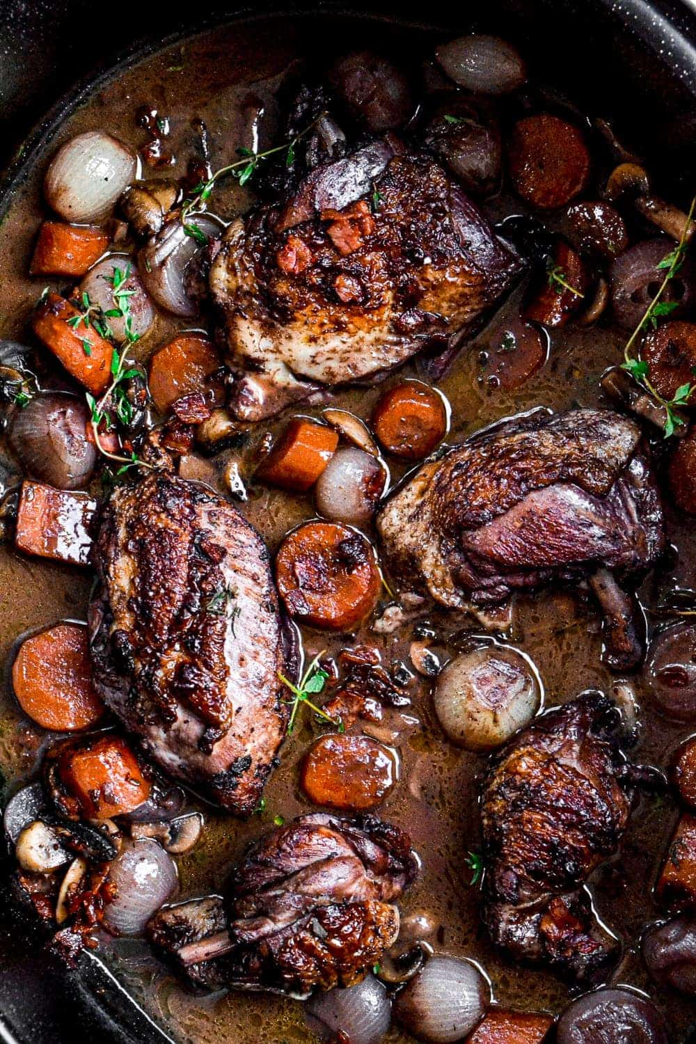 Top shot of Chicken Coq a Vin in a dutch oven