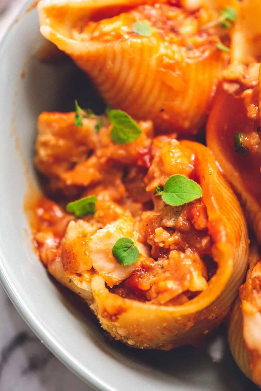 up close image of chicken parmesan stuffed shells