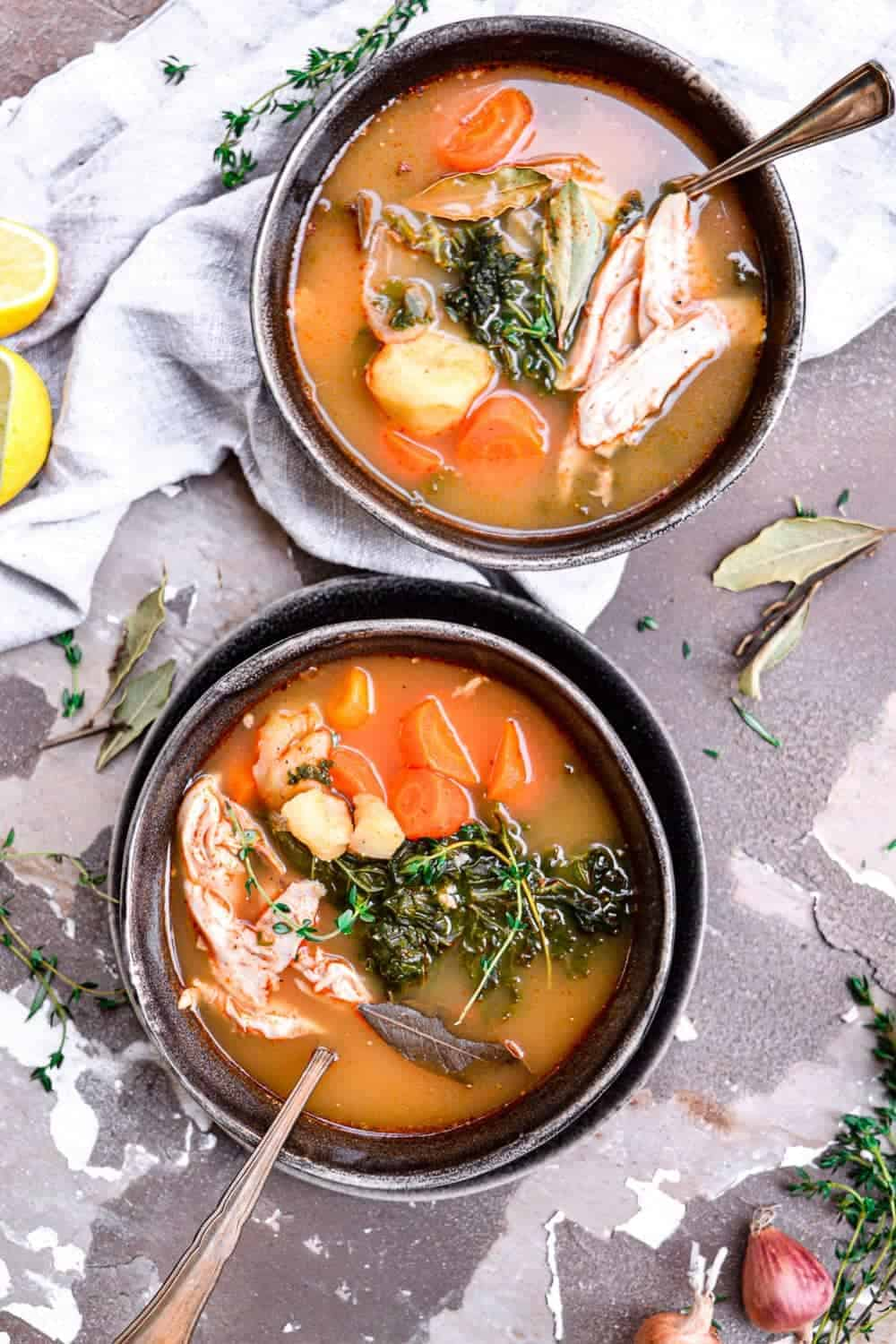Chicken soup in bowls with spoons