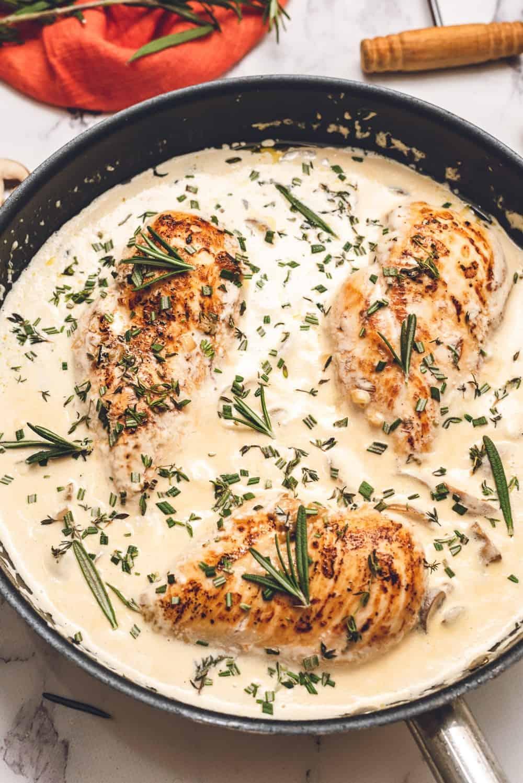 creamy garlic chicken in skillet