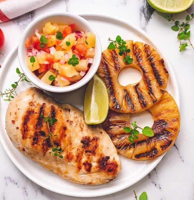 grilled chicken and pineapple on a plate