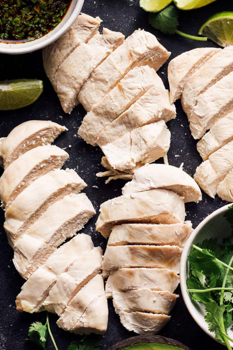 how to poach chicken - sliced poached chicken on plate