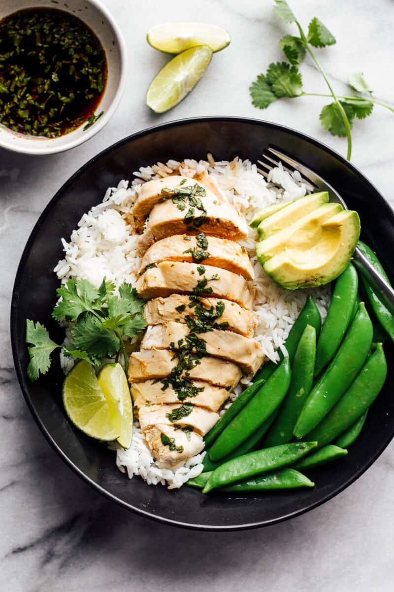 poached chicken with rice and green beans on plate