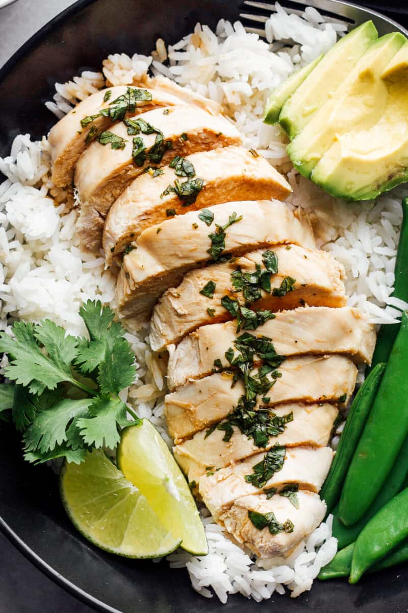 poached chicken on plate with rice