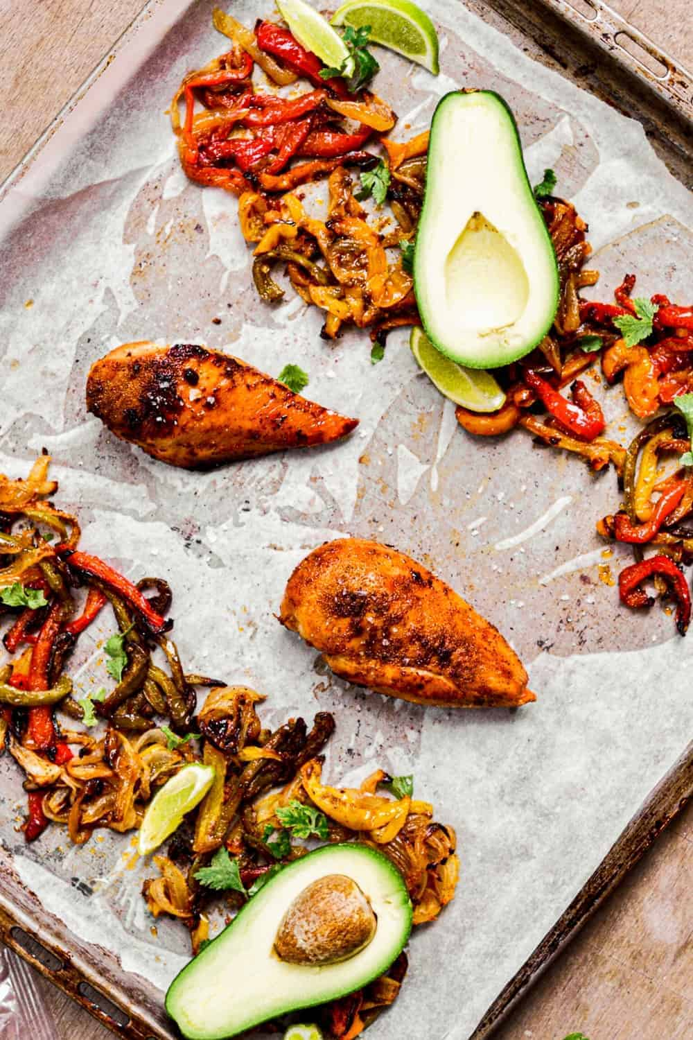 chicken and bell peppers on parchment paper