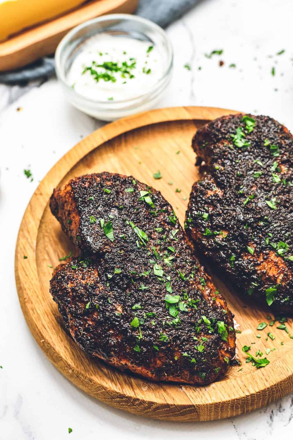 two blackened chicken breasts on plate