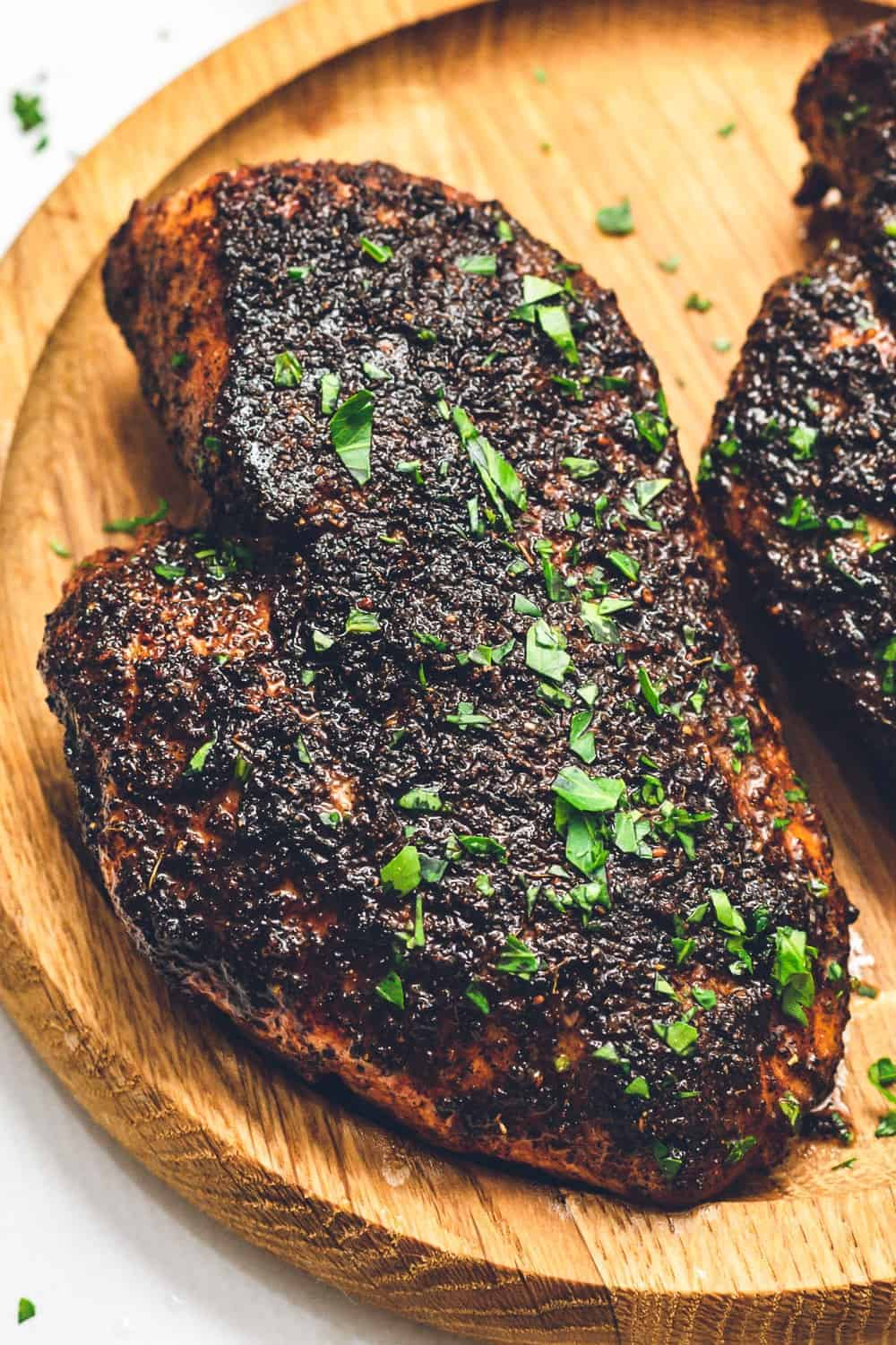 up close image of blackened chicken on plate