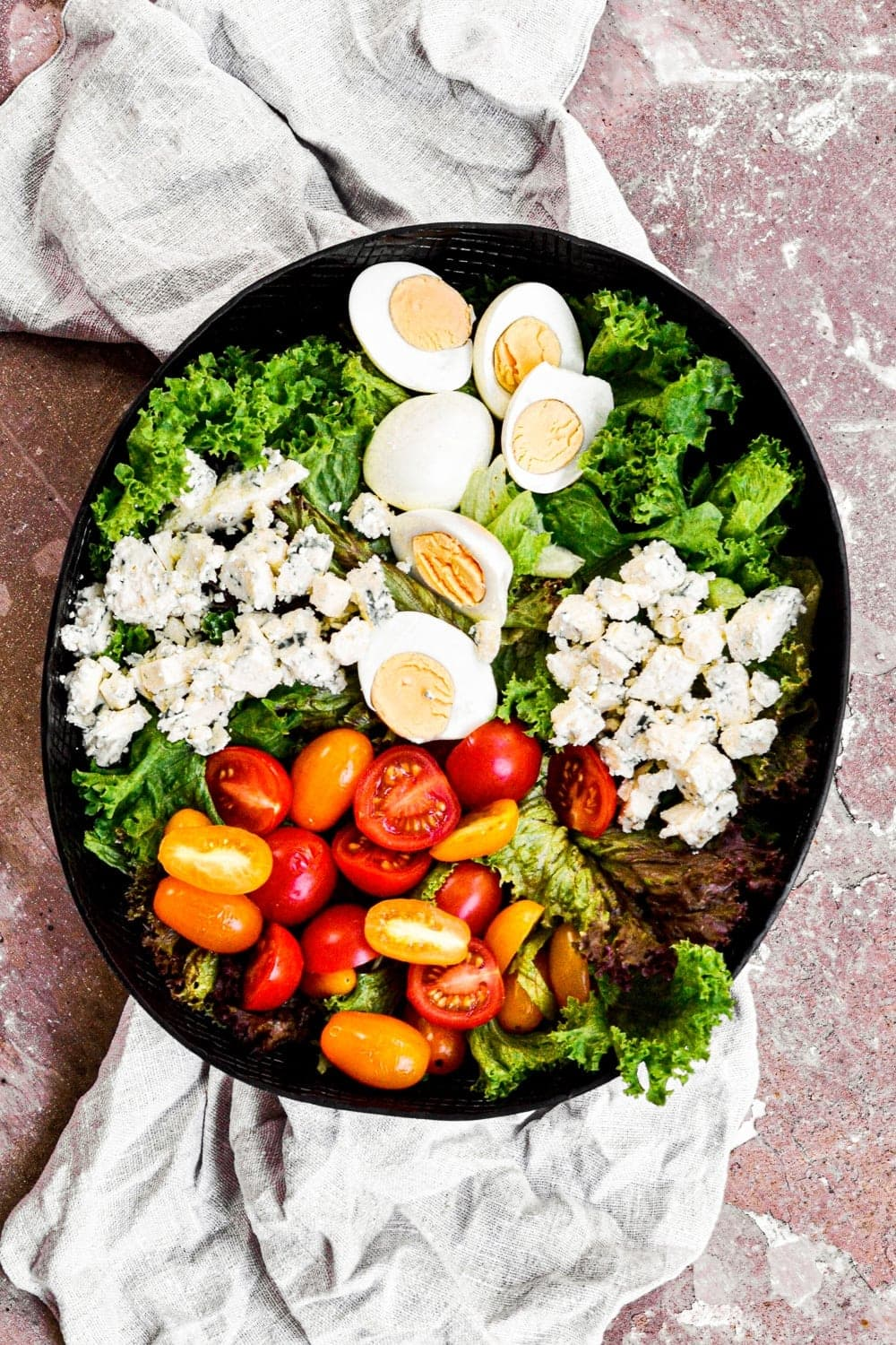 overhead shot of eggs and salad greens