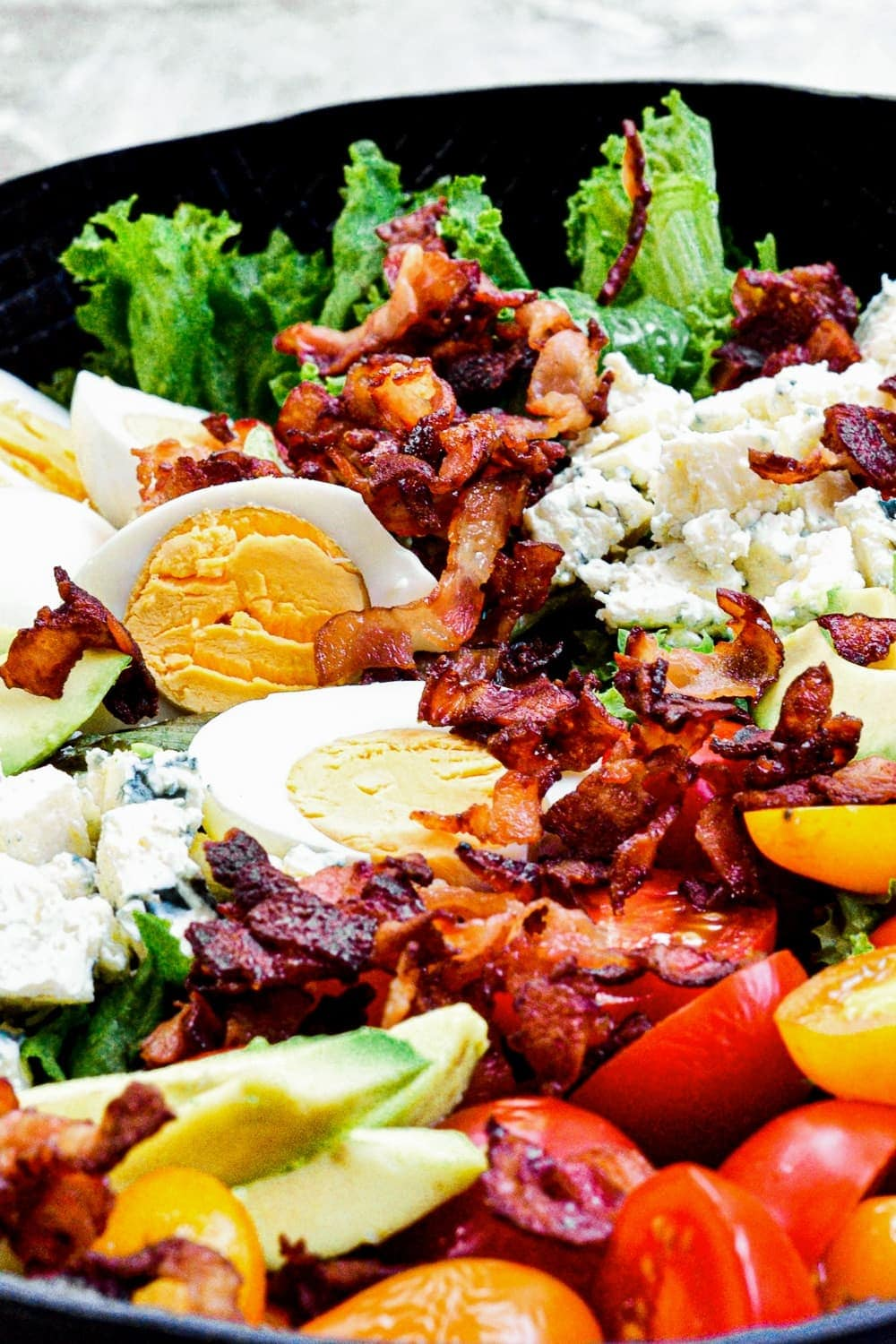 close up of bacon on chicken cobb salad