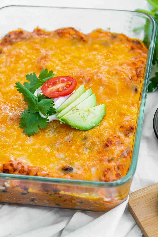 baking dish containing chicken enchilada dip