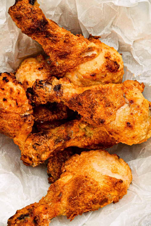 a batch of crispy oven fried drumsticks
