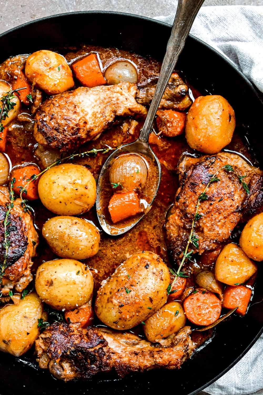 chicken stew with potatoes in skillet