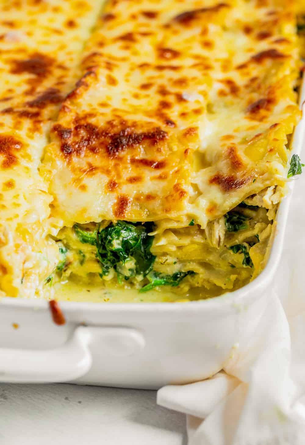 close up of a corner of white chicken lasagna