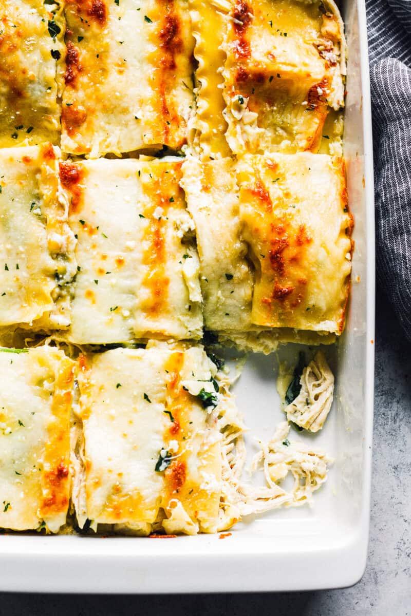 sliced white chicken lasagna in baking dish