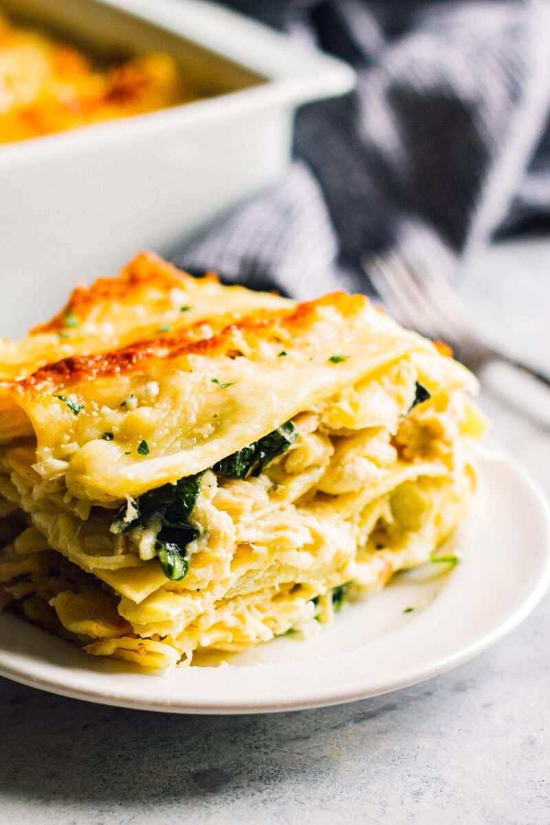 side shot of slice of white chicken lasagna