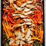 sheet pan chicken fajitas with sliced chicken and vegetables