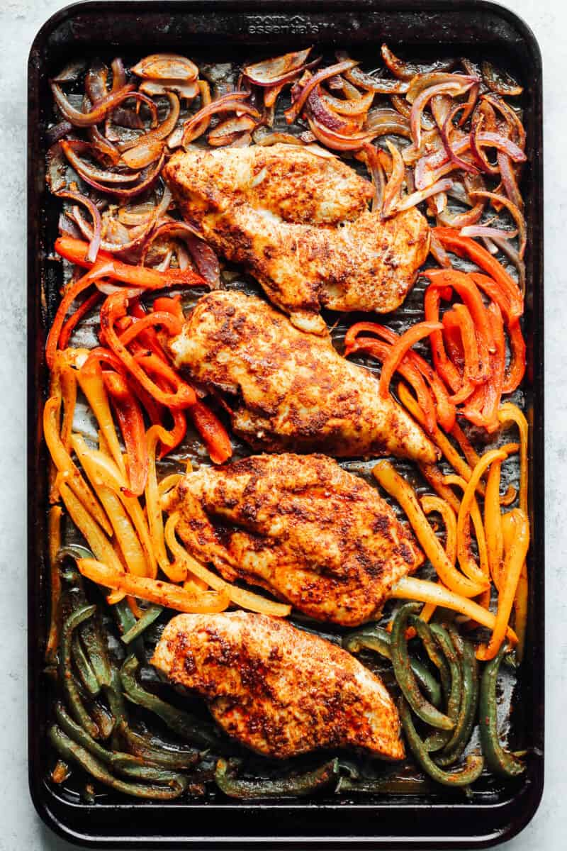 chicken fajitas and vegetables baked in the oven