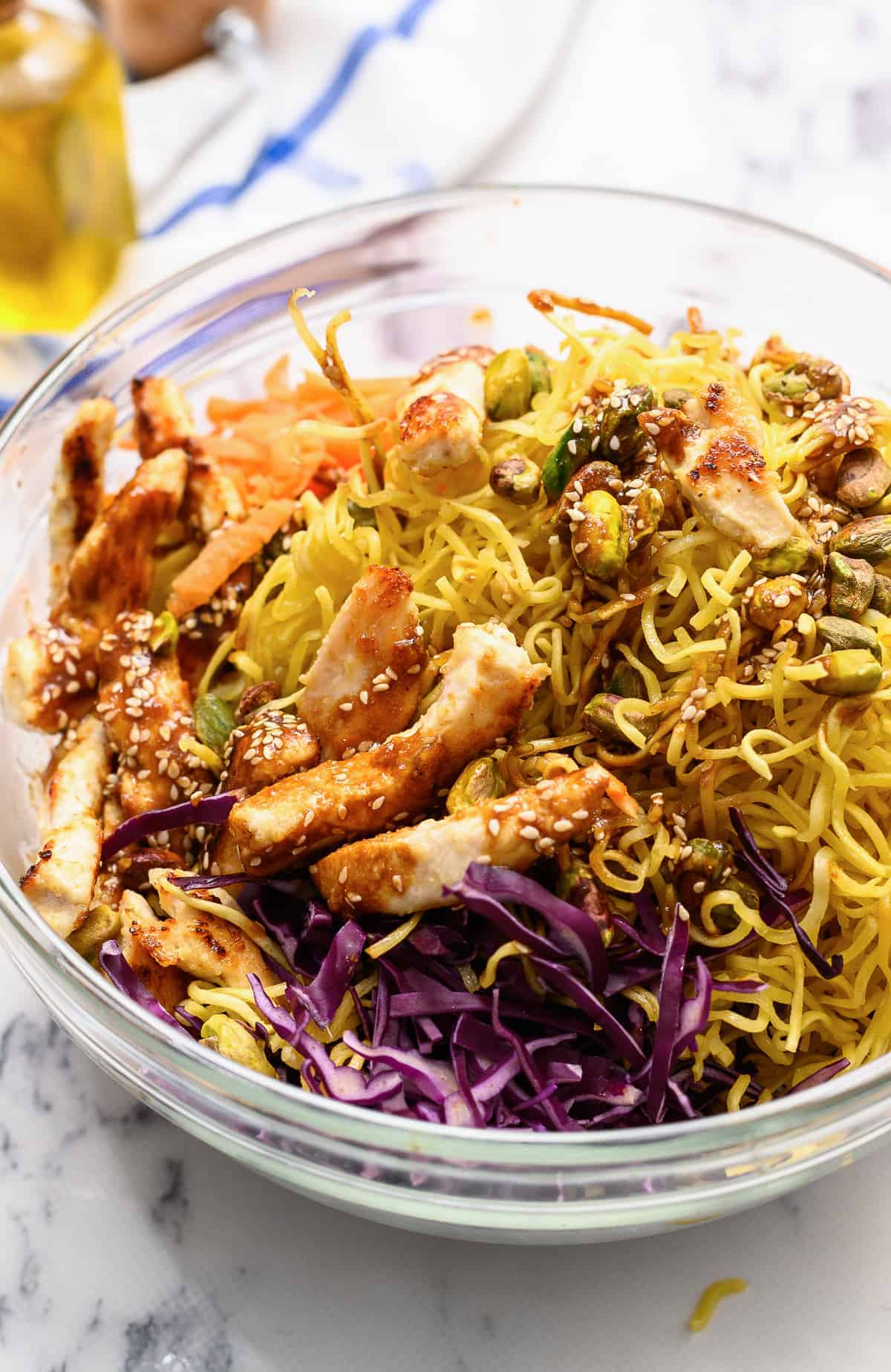 up close image of chinese chicken salad with noodles