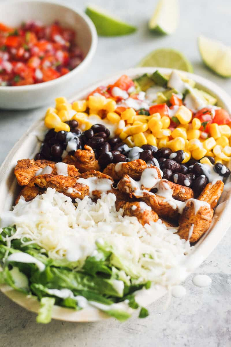 side shot of chicken burrito bowl from chipotle