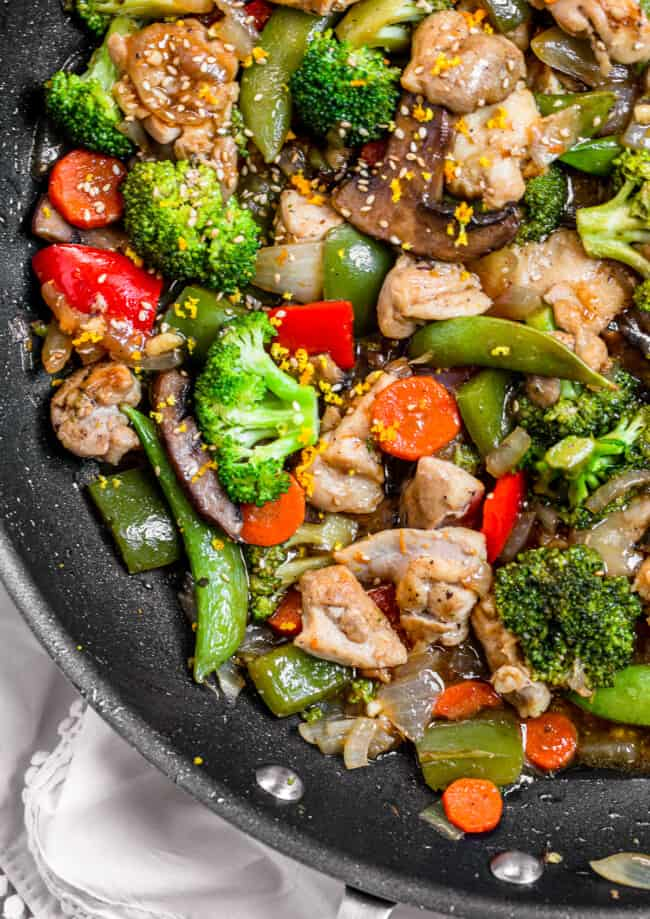 orange sesame chicken stir fry in a skillet