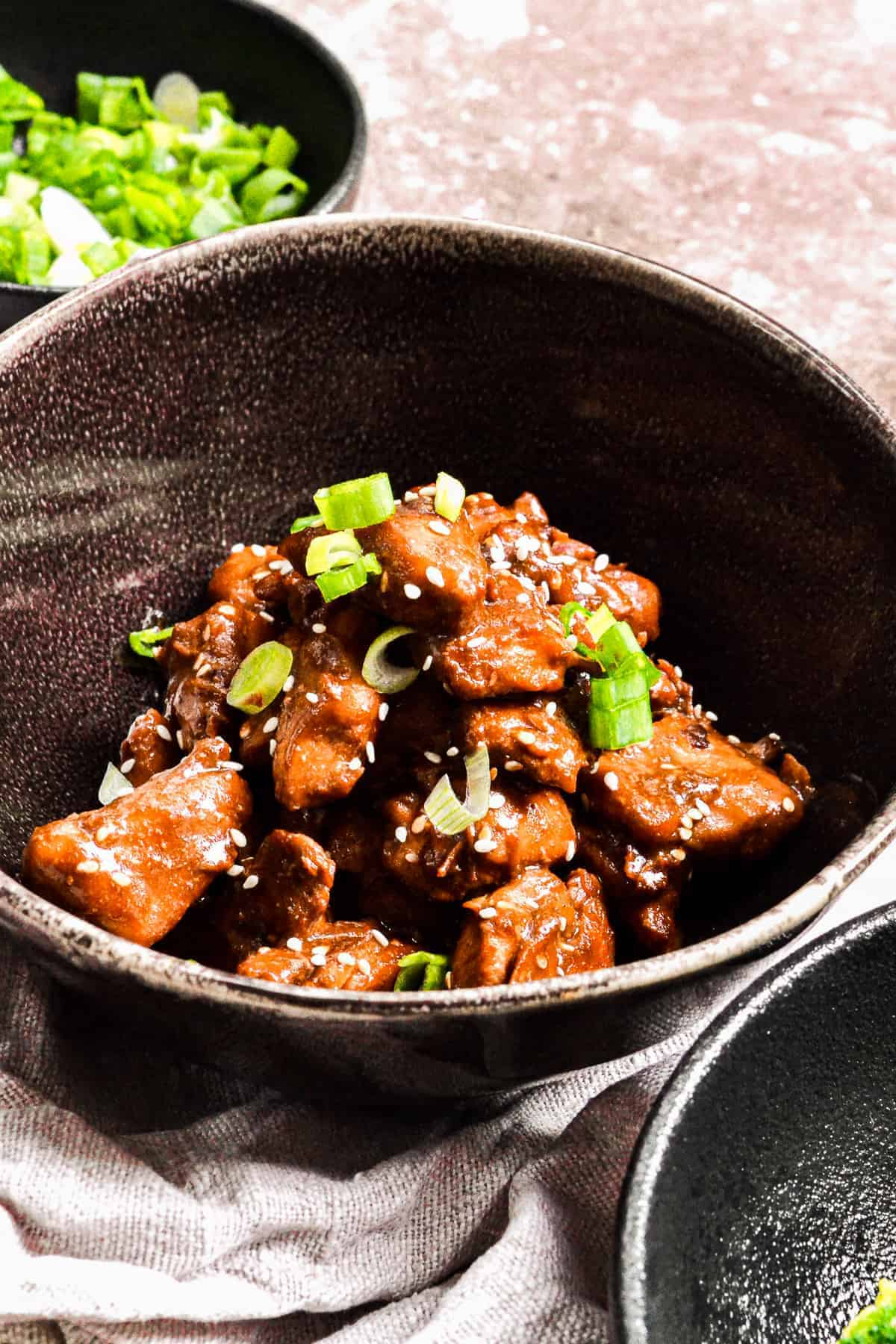 side shot of easy teriyaki chicken in a bowl