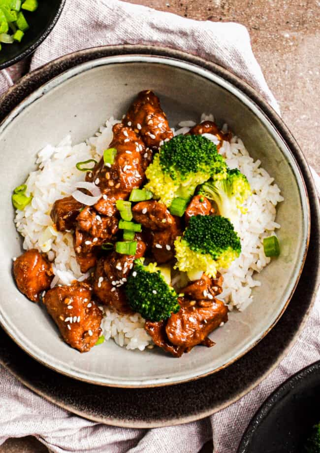 bowl of teriyaki chicken with rice and broccoli