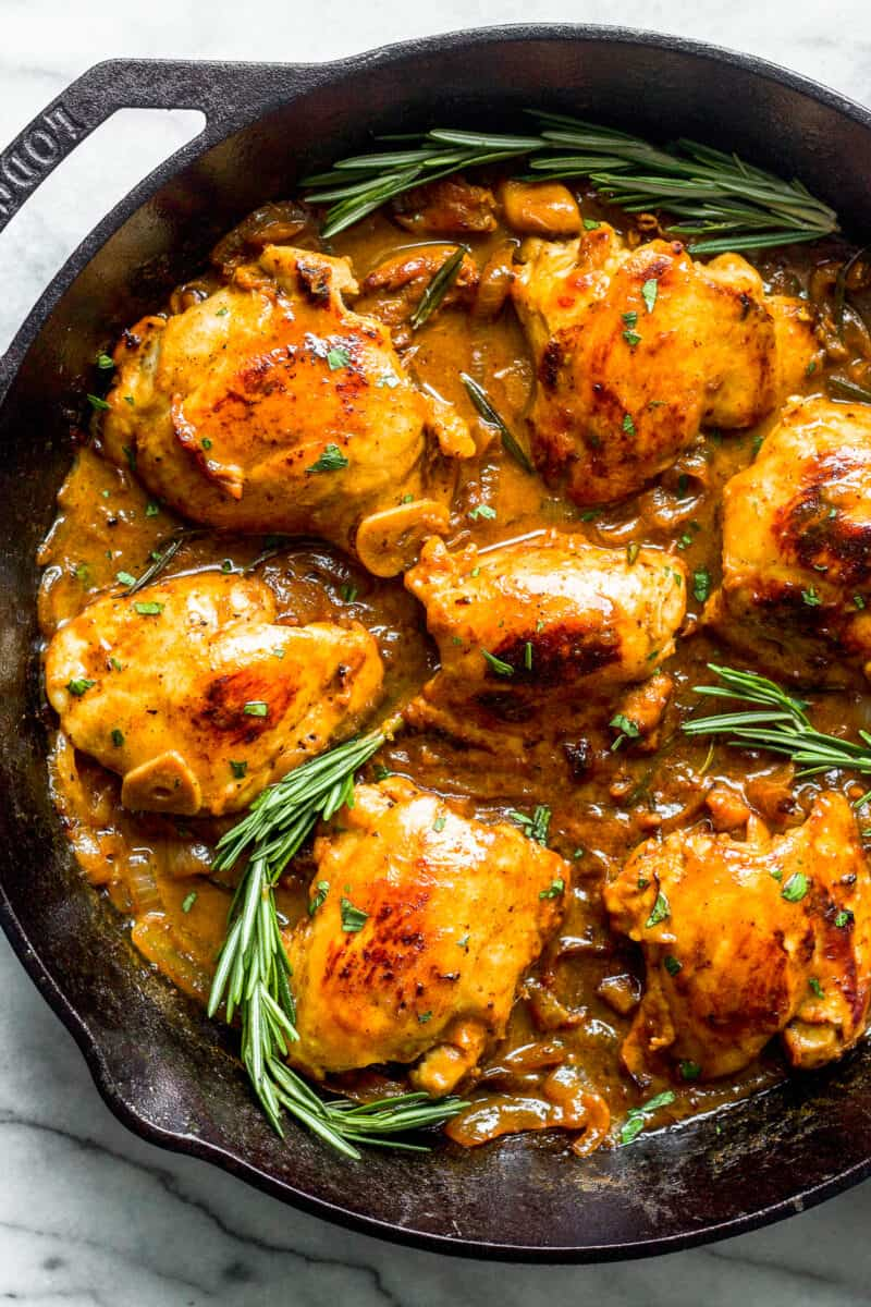 honey mustard chicken skillet garnished with rosemary