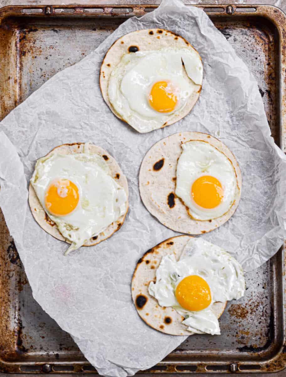 eggs on tortilla on baking tray