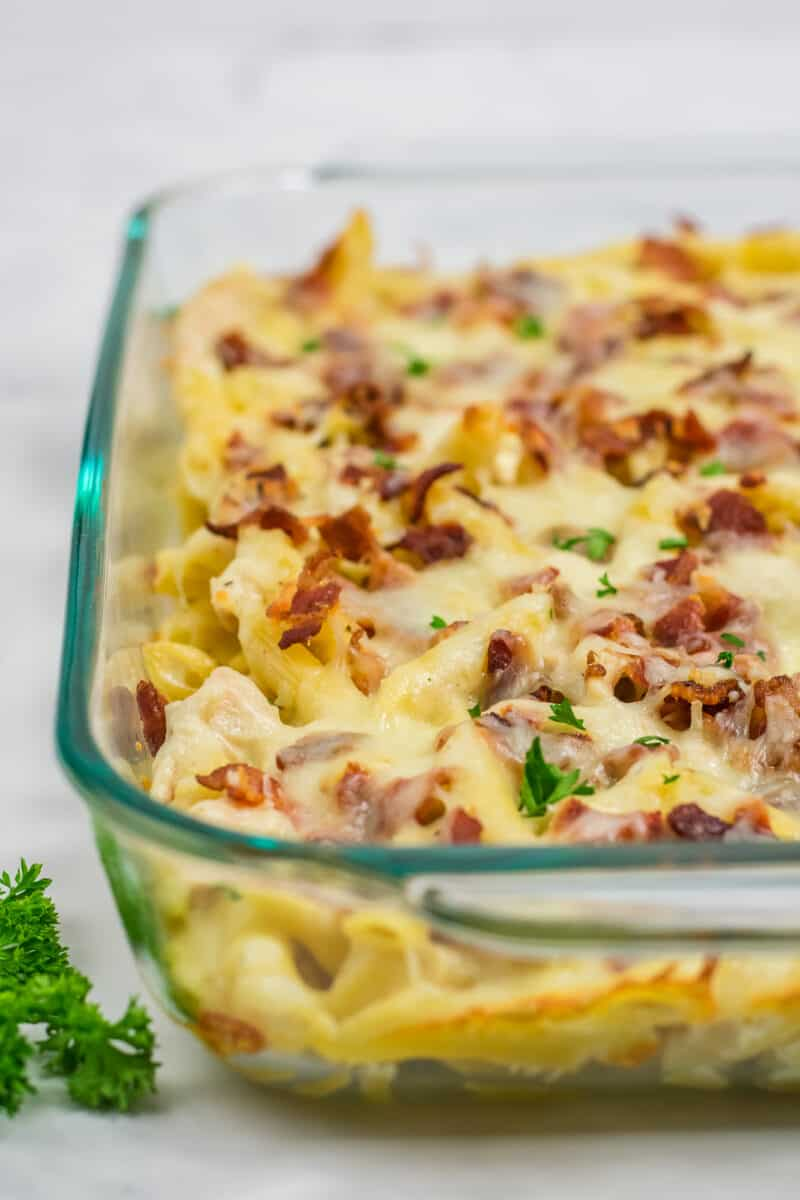 Close up of the bacon and cheese on top of the chicken ranch pasta bake