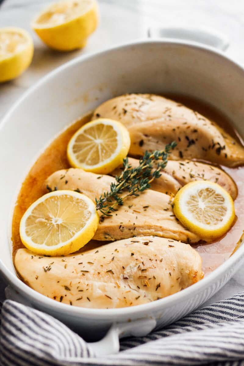 baked lemon chicken in white dish