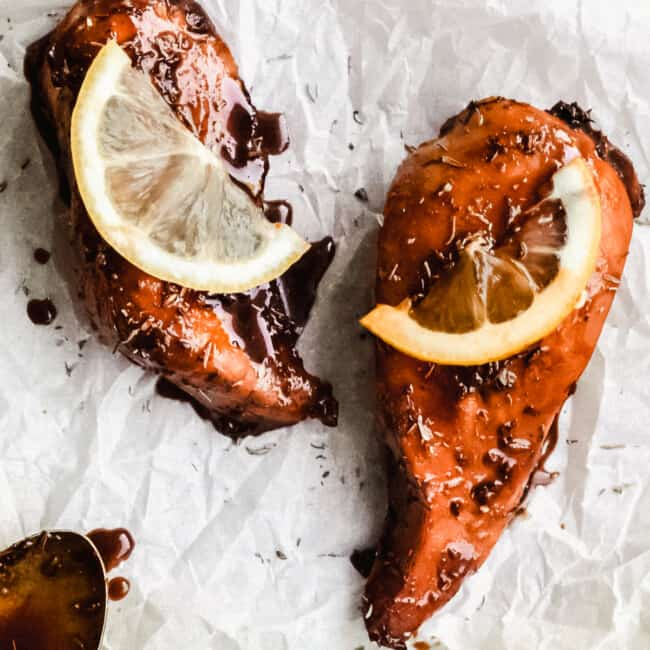 baked balsamic chicken with lemon on parchment