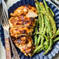 mozzarella chicken on a plate with green beans