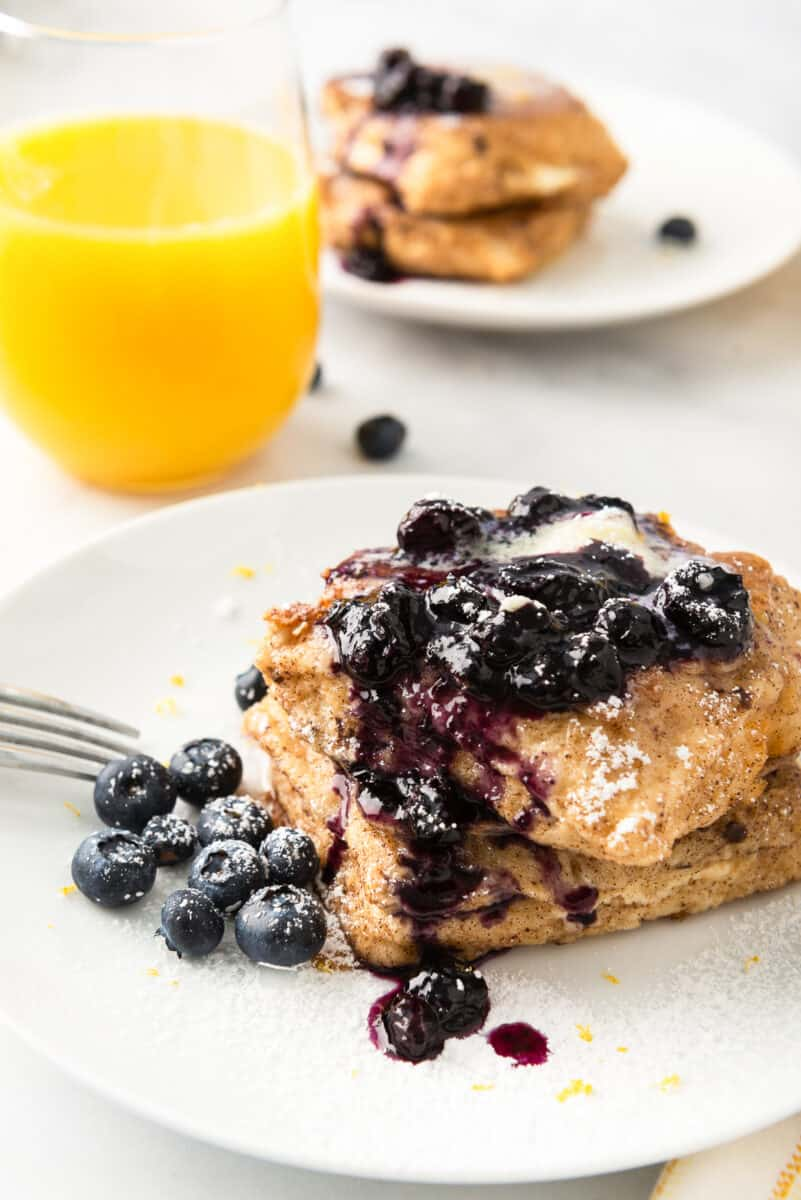 stuffed french toast with blueberry syrup on plate
