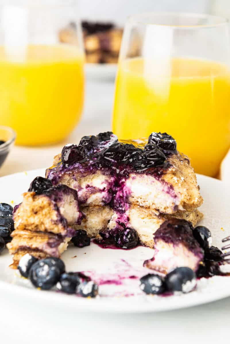 stuffed french toast with blueberry sauce on plate