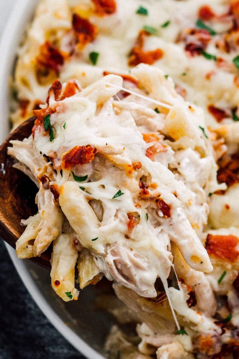 lifting up cheesy chicken bacon ranch pasta bake